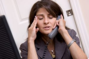 woman on phone with headache